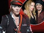 Johnny Depp is pictured performing with his band, The Hollywood Vampires, in London on June 20