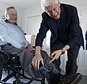 "Former Democratic President Bill Clinton jokes with former Republican President George H.W. Bush as Bush shows off a pair of ""Bill Clinton socks,"" while Clinton visits Bush at his home in Kennebunkport, Maine, Monday, June 25, 2018. (Evan F. Sisley/Office of George Bush via AP)"