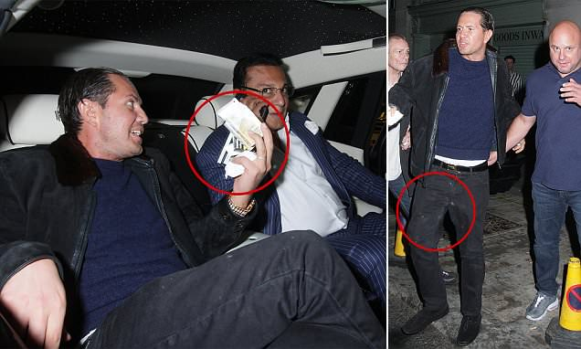 James Stunt holds bag of white powder as he exits Mayfair nightclub