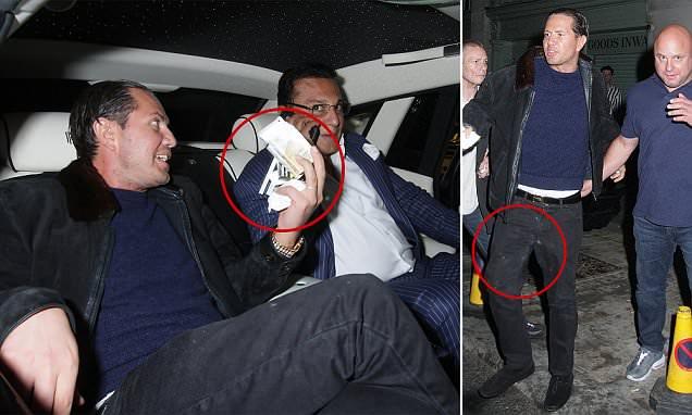 James Stunt holds bag of white powder as he exits Mayfair nightclub