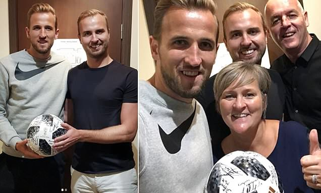 Kane poses with proud parents and brother with hat-trick match ball