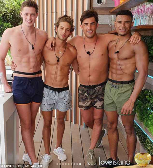 Hunky: Also included was a steamy snap of the boys as they posed in their swimsuits, showing off their chiseled abs poolside