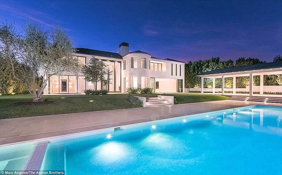 Lavish: The former Bel-Air home of power couple Kim Kardashian and Kanye West (above), which the pair spent $2m on renovating, is back on the market just seven months later, reports TMZ