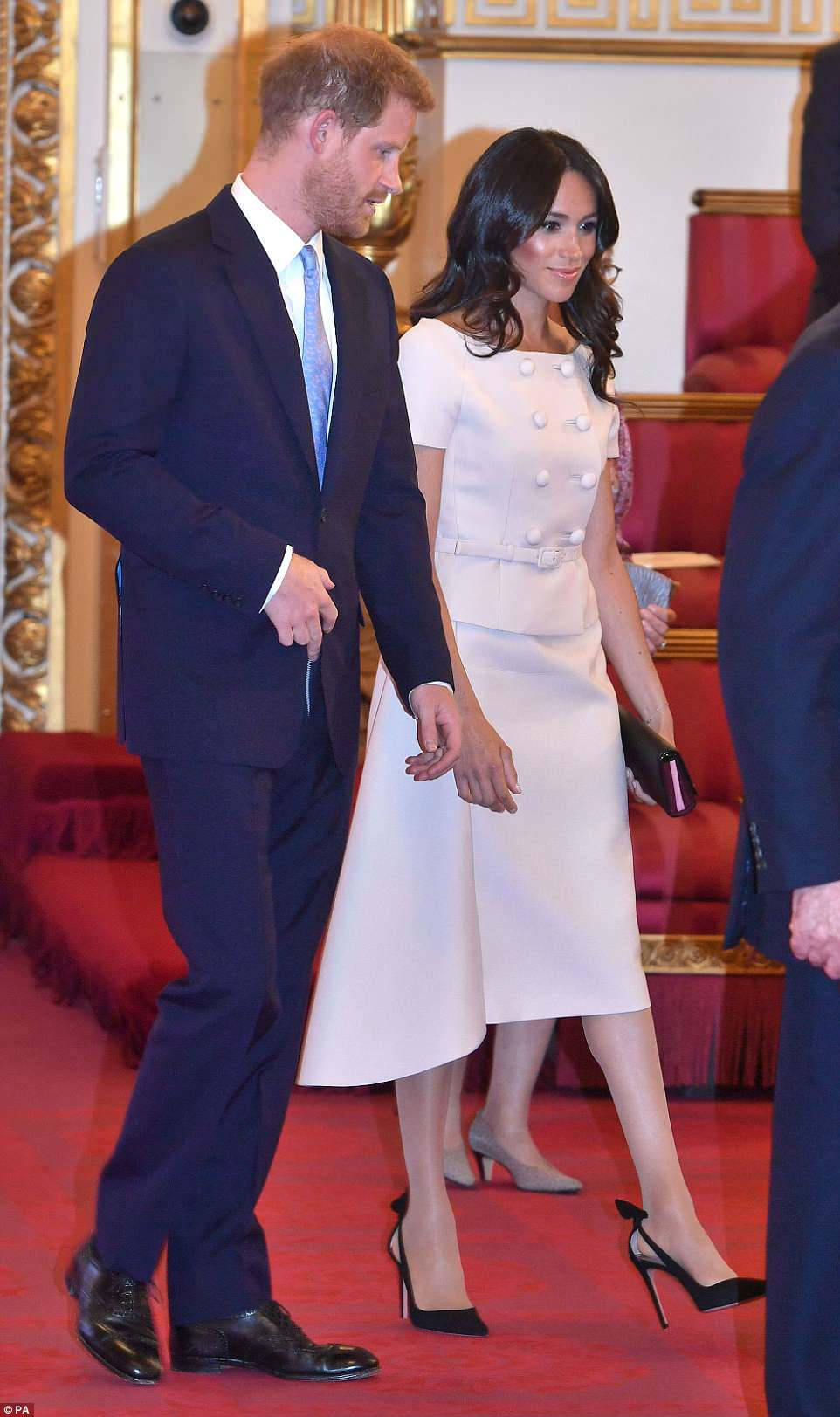 New look?The newly-minted Duchess of Sussex, 36, earned comparisons to her sister-in-law Kate with a curly new 'do. HerThe double-breasted Prada number featured a thin belted waist, a peplum-effect bodice and an asymmetrical skirt