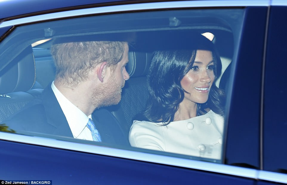 The pair were seen arriving at Buckingham Palace earlier tonight ahead of the Queen's Young Leaders reception. Meghan's dresslooked strikingly similar to the Carolina Herrera ensemble she wore for Trooping the Colour