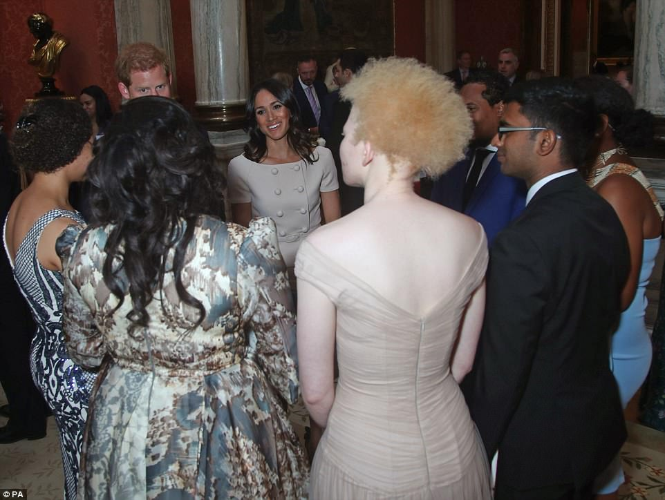 Popular: The crowds all wanted a chance to mingle with the royals as they gathered around the couple at the formal occasion