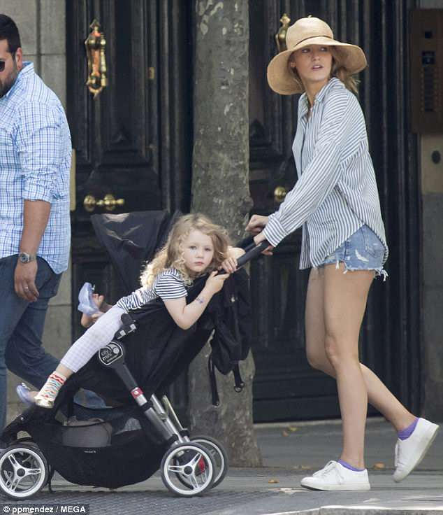 Time off: Blake Lively looked every inch the doting mother as she took her daughters for a relaxing stroll in Madrid, Spain earlier this month