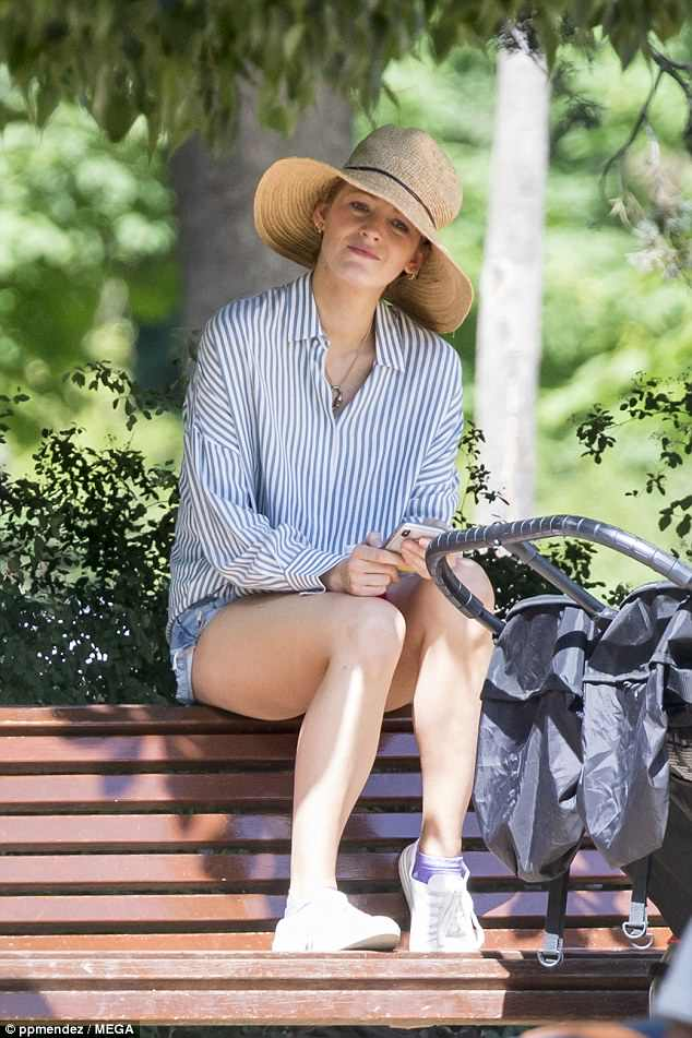 Low-key: The 30-year-old actress flashed a glimpse of her leggy pins in a pair of denim shorts, tied in with a chic striped shirt