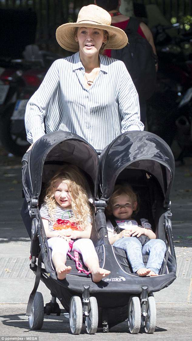 Cuties! Daughters James, three, and Inez, one, looked in great spirits on the outing