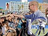 The Duke of Cambridge doesn't know where to look as he is greeted by admirers as he arrives at the Frishman beach in Tel Aviv