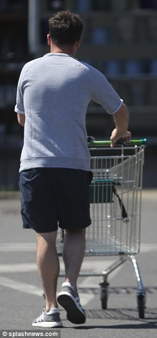 Relaxed style: Ant nailed his summer look, cladding his physique in a simple light grey top and navy shorts while strolling along in a pair of comfortable trainers