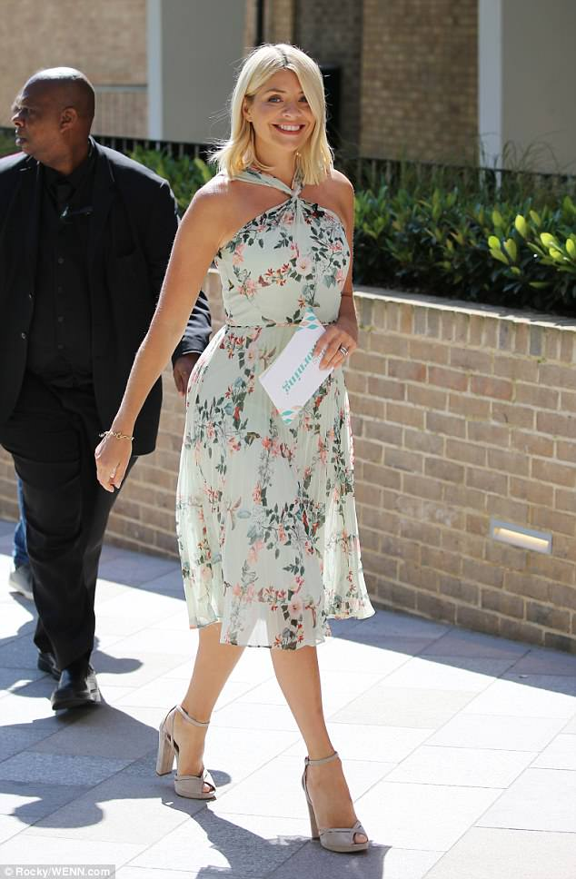 Amazing: Holly Willoughby oozed summer chic in a pretty floral halterneck dress on Tuesday as she headed into the blazing sunshine to host This Morning with Phillip Schofield