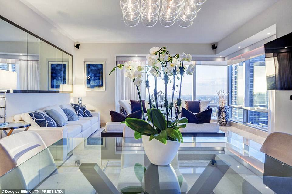 Luxurious: The apartment is based around a neutral colour scheme of grey and ivory, and includes floor-to-ceiling windows overlooking the Miami skyline