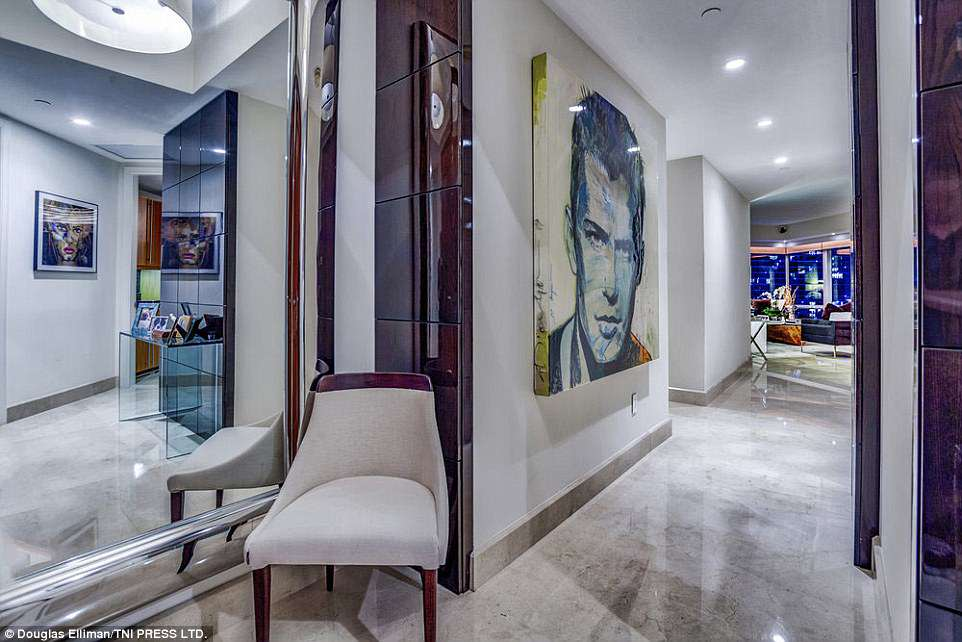 Extra touches: The property also boasts some retro artwork to finish off the decor, and perfectly-placed mirrors utilise the space