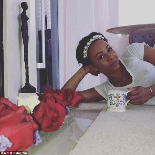 Fun:Mel B has given fans an inside look at her  California home, which boasts a Spice Girls costume room and even a Meghan  and Harry mug taking pride of place in her stunning kitchen