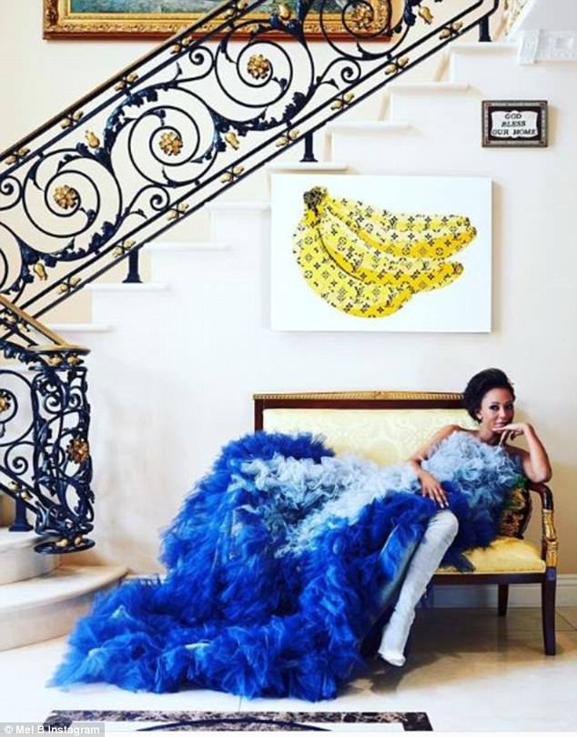 Palace!:And inside the Hollywood mansion could be mistaken for a palace, as the singer's entrance hallway is decked out with lavish white marble with a sweeping open staircase