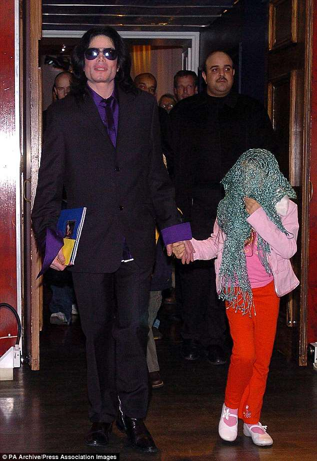 Disguised: The Beat It singer welcomed Paris and Prince during his marriage to former dental nurse Debbie Rowe (Michael and Paris pictured in 2005)