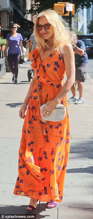 Work it:The blonde beauty stood out from the Manhattan crowds in her neon hued maxi dress, which was dotted with a purple floral print