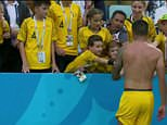 After Australia's disappointing loss, Socceroos forward Tim Cahill was filmed approaching a young fan in the stands with his jersey in hand