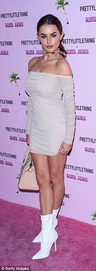 Jaw-dropping: Amber also showed some serious leg in a nude bardot dress and white ankle boots