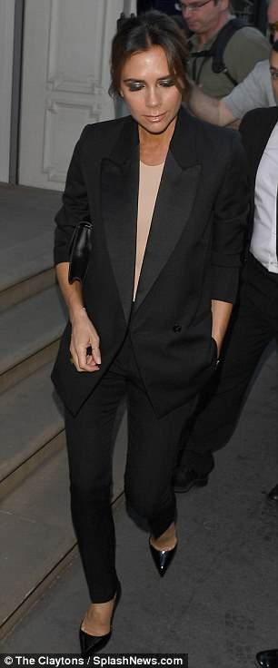 Tasteful:Victoria, 44, looked typically subdued in a sophisticated black trouser suit comprised of loose fitting double-breasted tuxedo jacket and pencil thin trousers as she made her way inside
