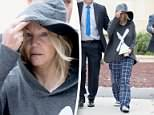 Sprung:Heather Locklear left jail shortly after 9am on Monday following her arrest the previous night (above)