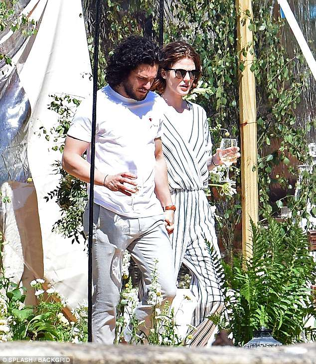 Delighted: The Game Of Thrones stars could not wipe the smiles from their faces as they enjoyed a glass of wine in the sunshine at the stunning castle - which Rose's family own