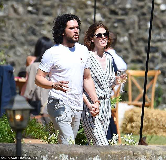 Delighted:The acting couple proved to still be on a high from their big day, as they enjoyed a glass of wine together the following afternoon