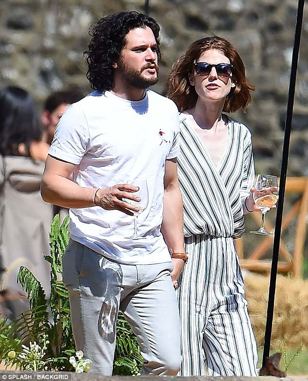 Chic: After stunning in an intricate beaded Elie Saab gown at the ceremony, Rose opted for a more casual striped jumpsuit as she stepped out with her husband
