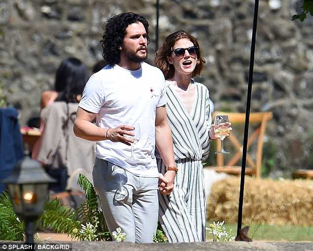 Casual: The actor meanwhile kept things equally low-key in a plain white T-shirt and chinos as he joined Rose in the garden