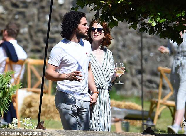 Soaking it up: The couple made the most of the British sunshine as they took a stroll around the stunning 12th century castle