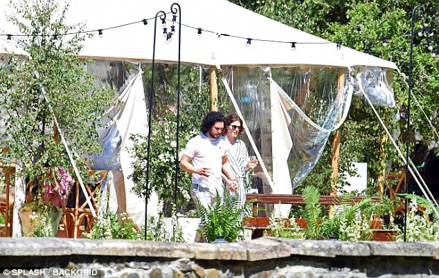 Continuing the party: They were later seen joining their family in a fairy light-lined marquee in the garden for further celebrations later on