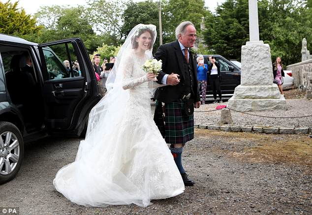 Gorgeous: Rose looked truly stunning in an intricate beaded Elie Saab gown as she headed inside on her kilt-clad father Sebastian's arm