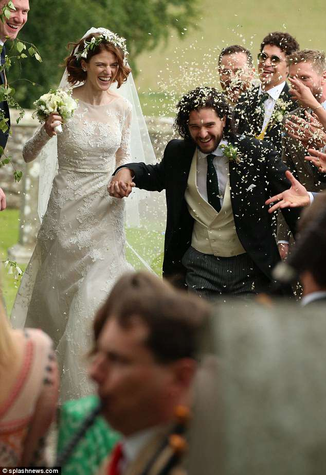 Hooray!The pair were pictured being showered with confetti by their friends and family after the wedding ceremony