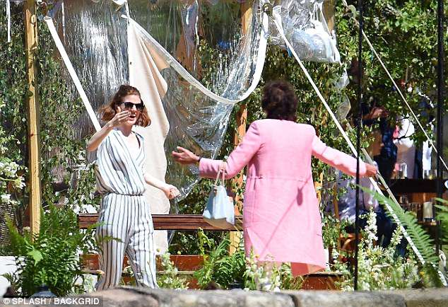 Delighted: Rose was later seen delightedly greeting another of their wedding guests