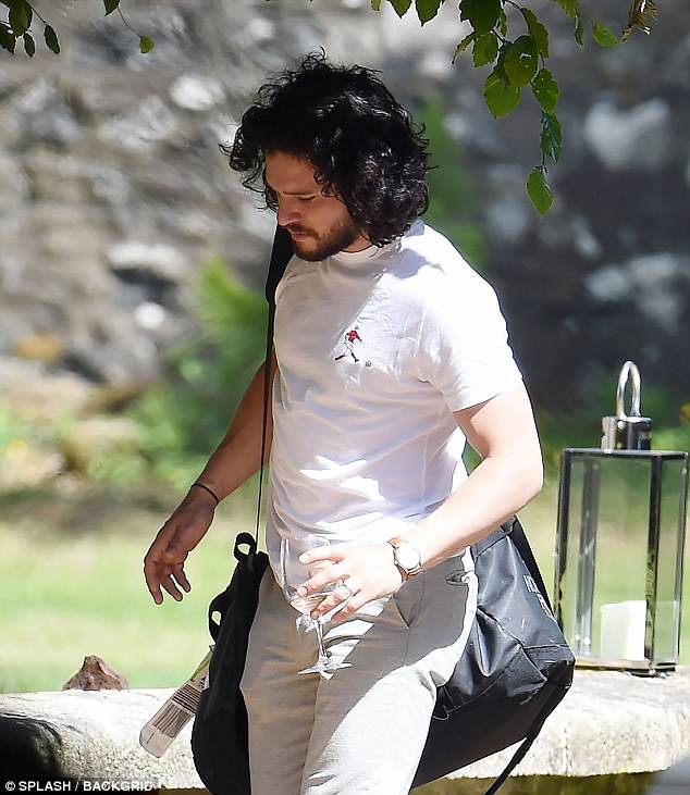Feeling good: Meanwhile Kit cut a relaxed figure as he headed to catch up with his family elsewhere