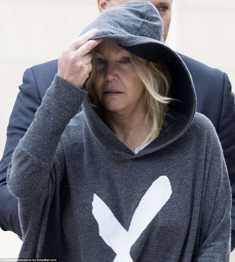 Sprung: Heather Locklear left jail shortly after 9am on Monday following her arrest the previous night (above)
