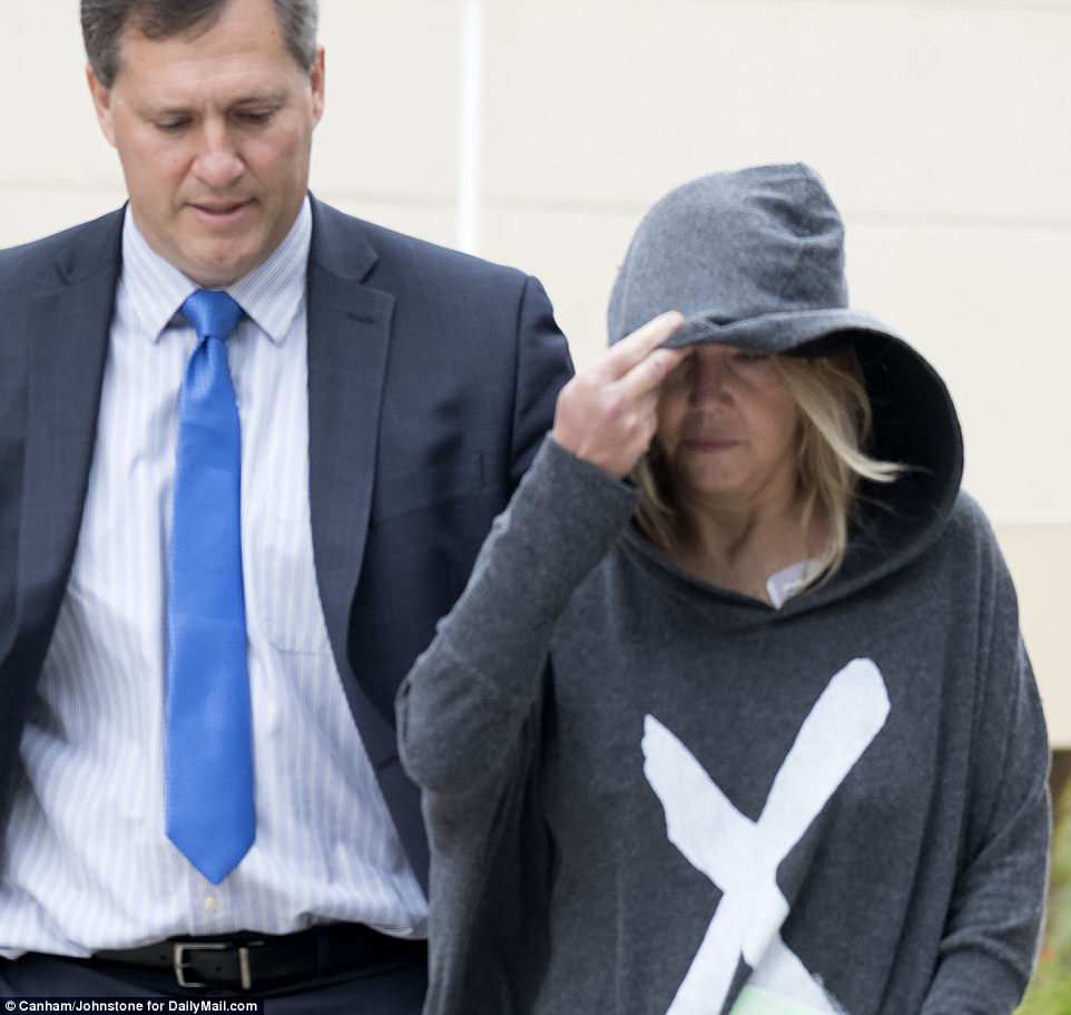 Straight hood: The actress was escorted by her lawyer William Haney (left), who posted her $20K bail