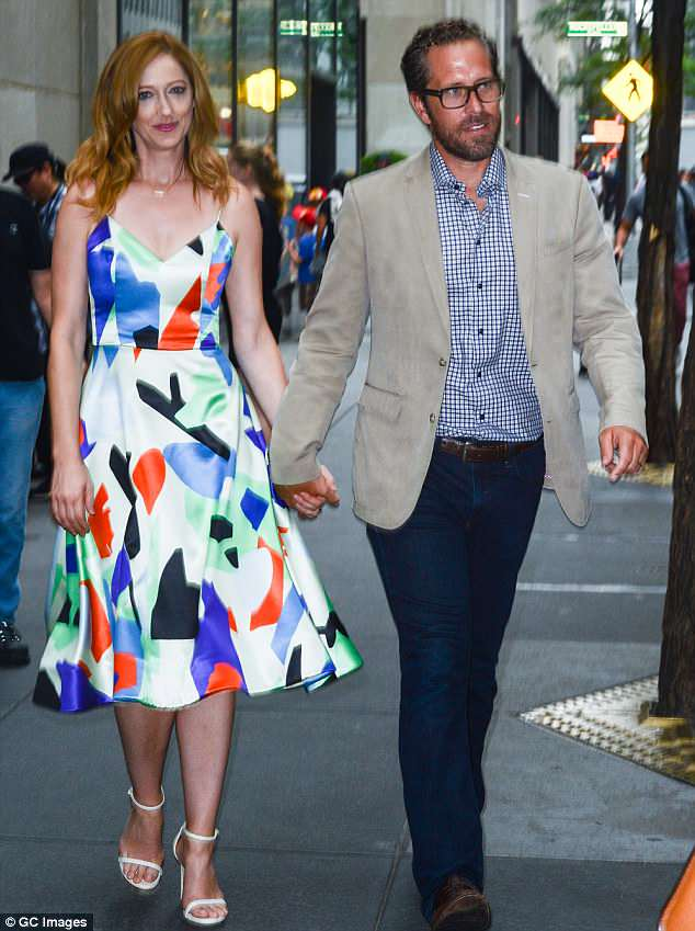 Cute couple: The Hollywood star is shown holding hands with her husband Dean E. Johnsen in July 2015 in New York City