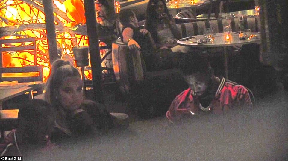 If looks could kill: Khloe Kardashian and Tristan Thompson's VERY tense dinner date as new mom looks sad and bored despite new bling... while cheating boyfriend checks his phone during dinner date at BOA on Sunset Boulevard on Sunday