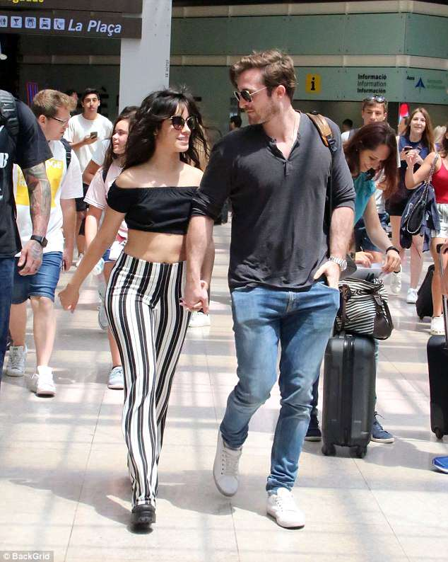 Loved up:Camila Cabello was spotted at the Barcelona airport with her beau Matthew Hussey on Monday