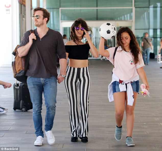 Body works: A pair of black and white striped leggings highlighted her lithe waist as they hugged her body tightly