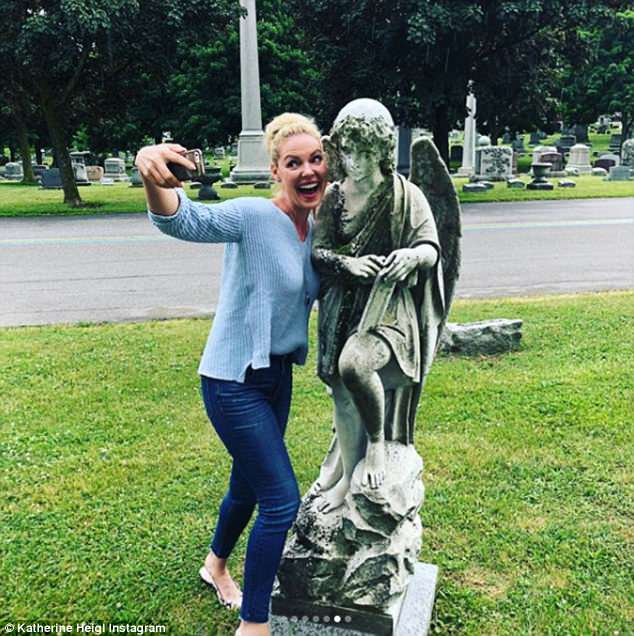 Heaven help her: The smiling actress also took a selfie 'with an impatient angel'
