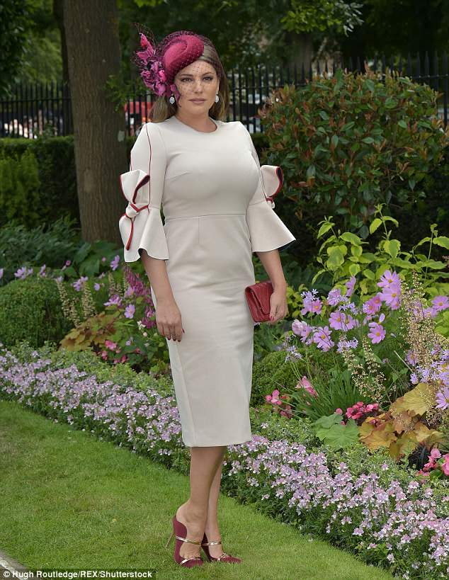All about the accessories:The garment was adorned with scarlet piping along the sleeves and an oversized bow, which complemented her crimson heels and clutch bag