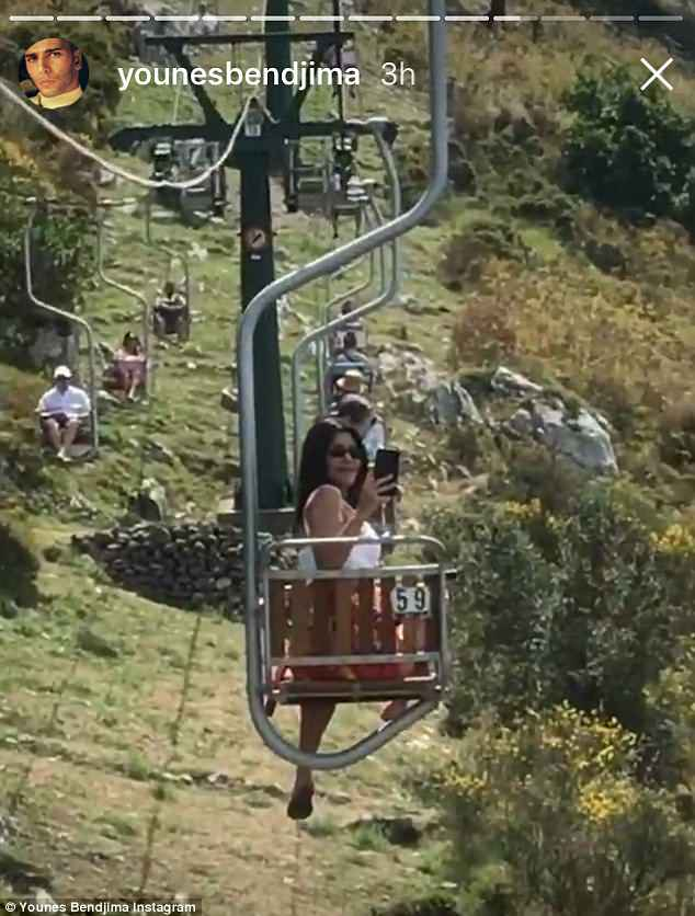 Up, up, and away: The couplemarveled at the sweeping Capri landscape as they rode a mountainside chair lift