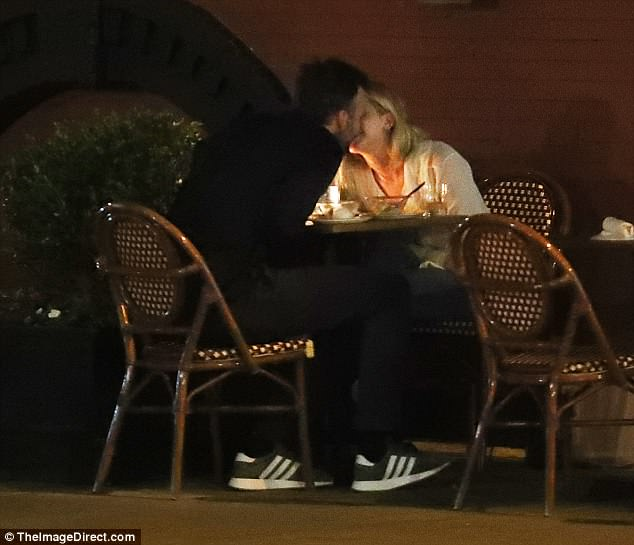 Smooching on the street: This comes just days after the leggy Kentucky native was seen kissing her new boyfriend Cooke Maroney after a cozy al fresco dinner