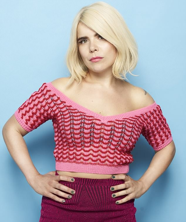 Stunning: Paloma Faith also designed her own trainers and posed in a striking pink and red ensemble