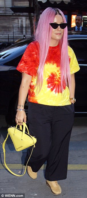 To dye for: Lily Allen arrived in an eye-catching outfit that included a bright yellow tie-dyed top