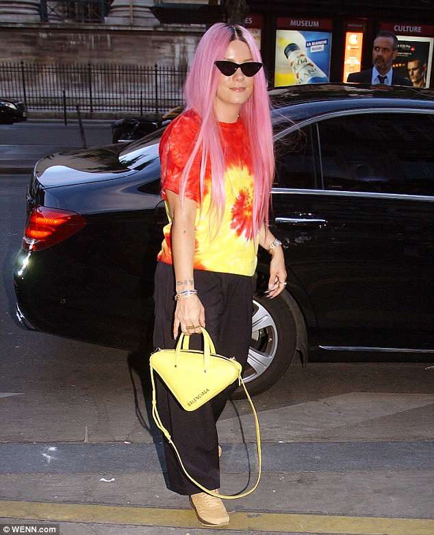 She's got it in the bag: Shielding her eyes behind a pair of cat eye sunglasses, the British singer carried a bright yellow Balenciaga bag