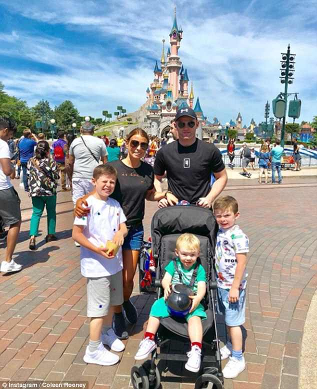 Happy families: Coleen Rooney cosied up to husband Wayne for an Instagram snap, as the couple enjoyed a family holiday to Disneyland Paris on Monday, with their sons
